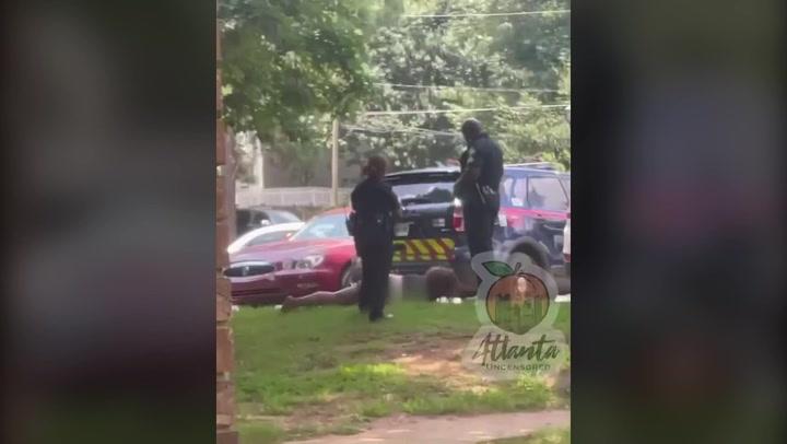 Atlanta police officer shockingly kicks handcuffed woman in face