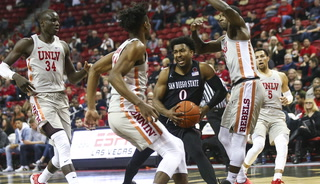 Rebels fall 60-59 to Aztecs, Robotham takes the blame