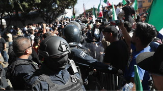 A bloody scene erupted in Tijuana Sunday when residents confronted the caravan of Honduran migrants