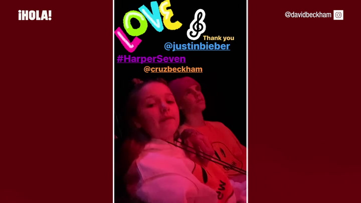 David y Harper Beckham en un concierto de Justin Bieber