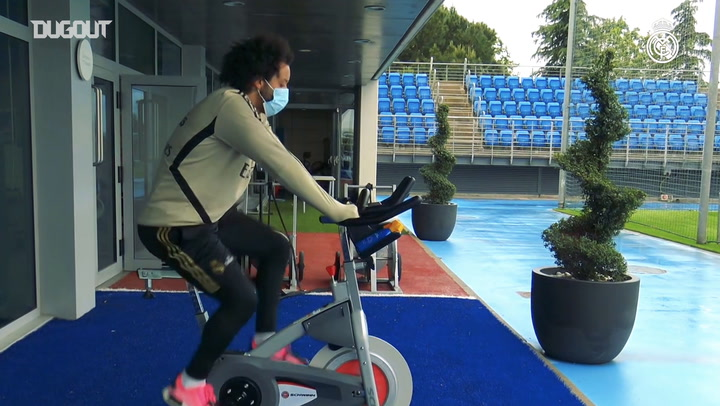 Real Madrid players train on exercise bikes
