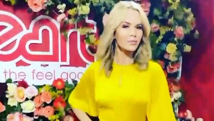 Amanda Holden struts in yellow satin dress