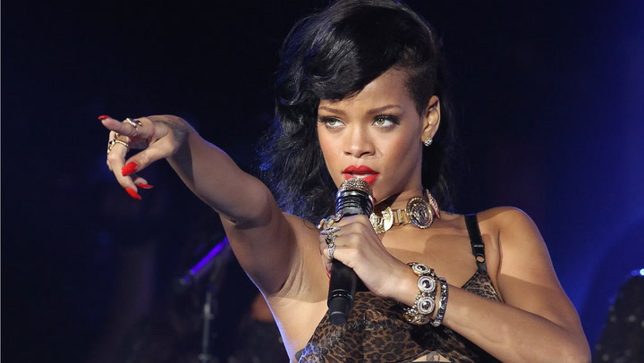 The app's stocks are down four percent after releasing a distasteful ad poking fun at Rihanna's domestic violence incident with R&B singer Chris Brown.