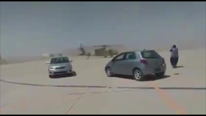 Moment Taliban appear to 'test drive' captured US-made helicopter
