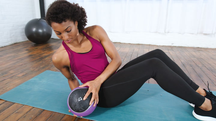 How to Use A Medicine Ball In a Seated Oblique Twist