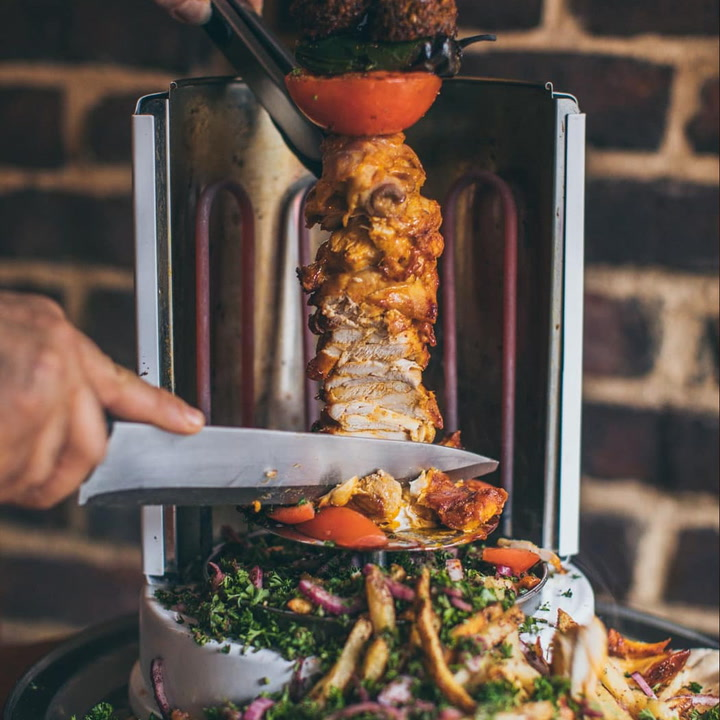 This Restaurant Serves Tableside Shawarma You Can Slice Yourself