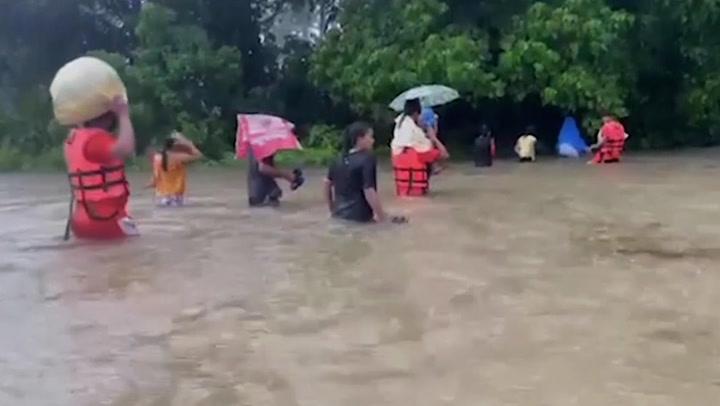 Tropical storm hits Philippines with flooding and displaces villagers