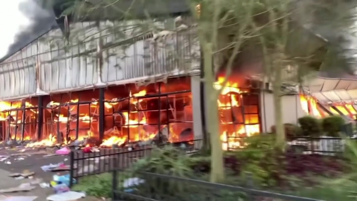 Shopping mall burns after looting in South Africa