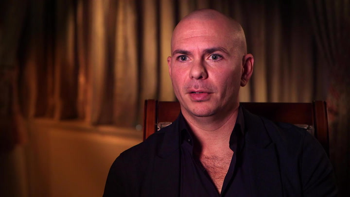 Pitbull Describes Working With Christina Aguilera, Kesha, & More Divas