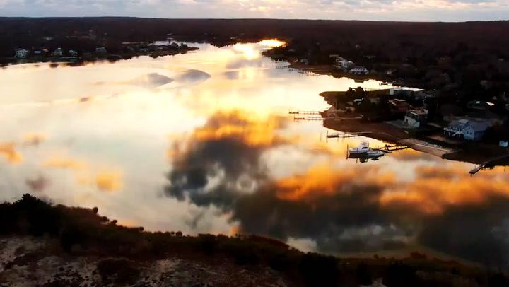Breathtaking morning sunrise reflects off water