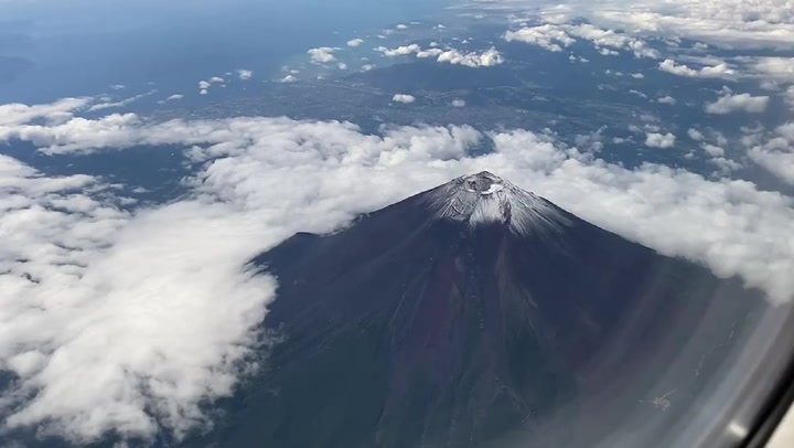 Mount Fuji's first snowcap of the season comes almost a month early