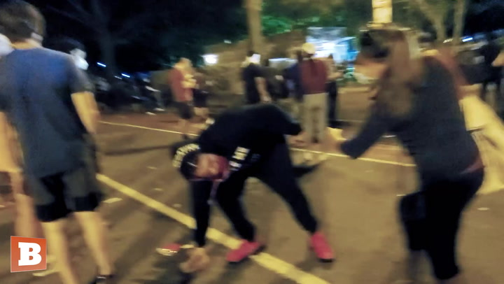 Woman Tries to Stop D.C. Rioter from Throwing Bricks at Cops, Told to 'F*ck Off'