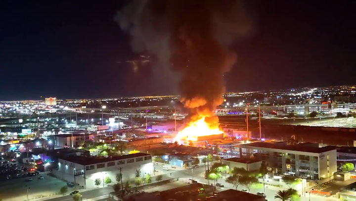 Huge fire erupts in central Las Vegas warehouse