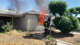 Heroes recognized for saving two men from burning home