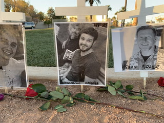 Memorial crosses left at Welcome to Las Vegas sign for victims of Thousand Oaks shooting