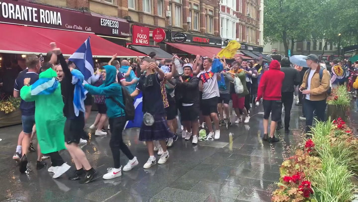 Fans conga through Leicester Square ahead Euro 2020 match