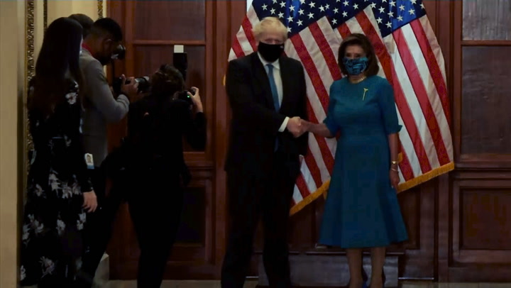Johnson and Pelosi awkwardly shake hands for more than a minute during Capitol Hill visit