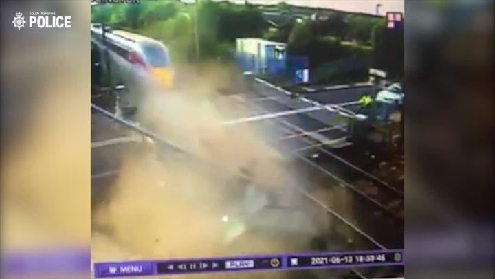 Drink-driver smashes Range Rover into speeding train in shocking CCTV footage