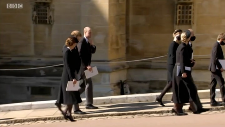 The Cambridges and Prince Harry walk together following Prince Philip\'s funeral