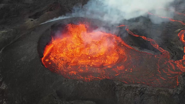 Drone flies over erupting volcano in Iceland to capture mesmerising footage