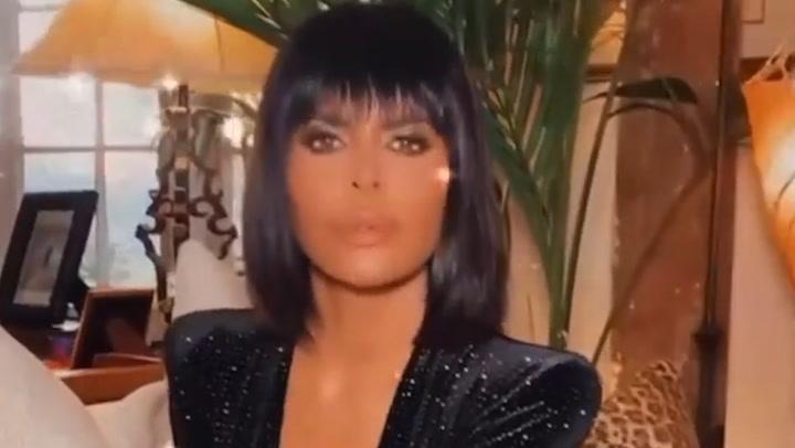 Lisa Rinna\'s brunette avatar and skintight catsuit