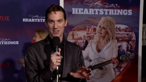 Queerty's David Reddish hits the red carpet for 'Dolly Parton's Heartstrings'