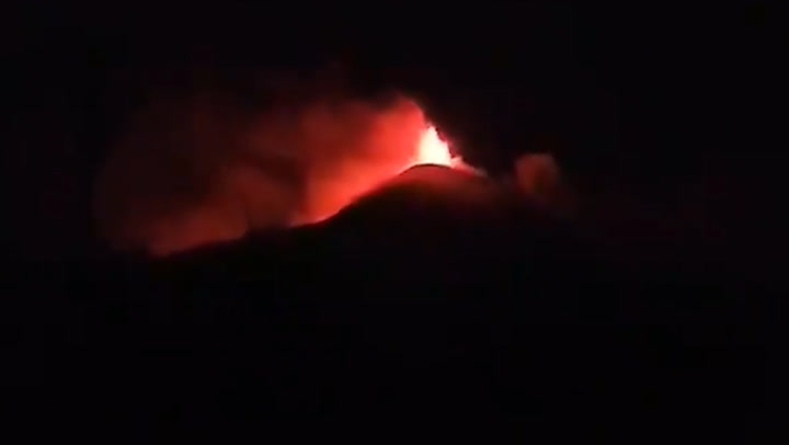 Lava spews into the air as volcano erupts