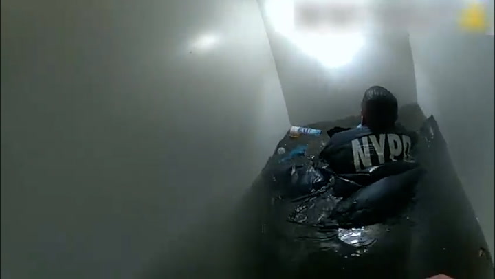 NYPD try to rescue family including two-year-old from flooded basement