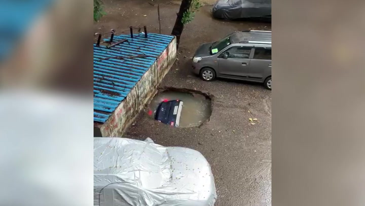 Car swallowed by the ground after heavy rain in Mumbai