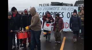 Protesters march against Enbridge in Carlton County