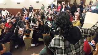 Minnesota state Rep. Tim Miller of Prinsburg reacts Tuesday to protesters who stopped a state House meeting. They objected to his bill to lease a private prison facility. (Forum News Service photo by Don Davis)