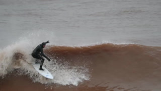 Surfers on Lake Superior during Friday's storm
