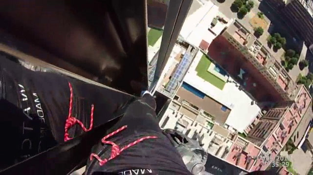 Raw: 'Spiderman' Scales Tower in Spain
