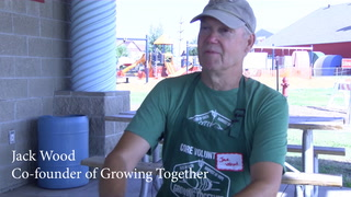 Growing Together volunteers sort through garden vegetables. Forum News Service