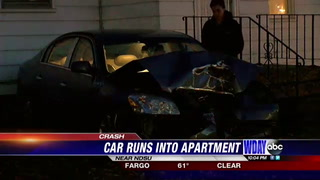 Car runs into apartment