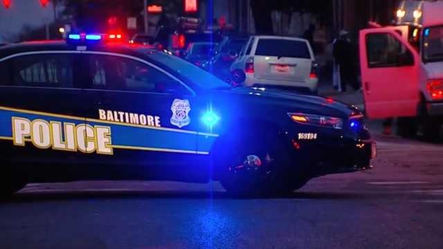 Search for gunman who shot Baltimore detective in the head