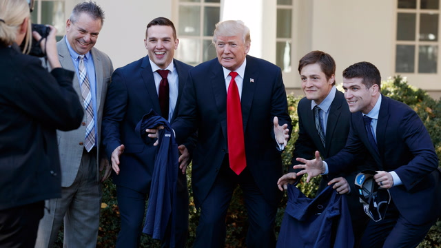 Watch Trump pose with plenty of people who like to win