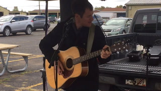 Shane Nelson performs at the farmer's market