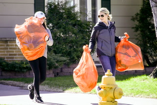 Young Professionals, volunteers collect items for nonprofits in Orange Bag Event