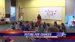 Youngsters learn the importance of voting with cookies at the Fargo Library