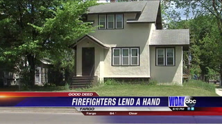 Fargo Firefighters help man in wheelchair mow his lawn
