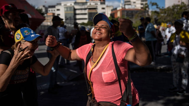 With their country at a crossroads, Venezuelans stage dueling rallies