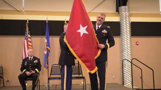 Connor Kruse (left) watches while Amy Kruse and 1st Lt. Jacob Kruse (right)  pin the new rank Saturday, Nov. 18, on Brig. Gen. Lowell E. Kruse, who assumed the duties as Minnesota National Guard Assistant Adjutant General-Army and the Camp Ripley Senior Commander on Oct. 1, 2017. The promotion ceremony recognized Kruse's new rank as well as his family and fellow soldiers. Steve Kohls / Forum News Service