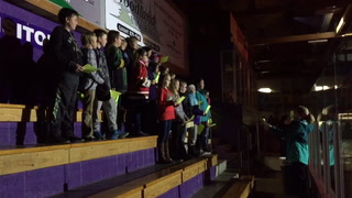 Churchill students sing the National Anthem before Wilderness game