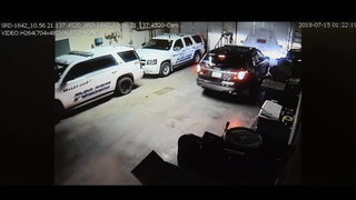 This image captured by a surveillance camera shows officers with Warren Lindvold in a Valley City police garage. Special to The Forum