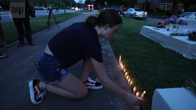 A city in mourning: Virginia Beach residents come together to find comfort
