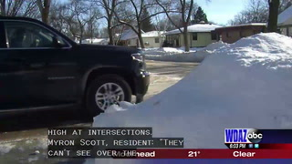 Snow piles blocking views at GF intersections