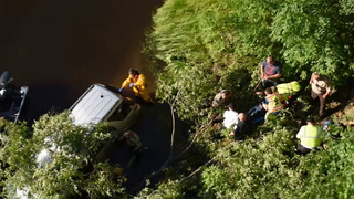 Woman Extracted From Partially Submerged SUV