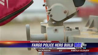 Fargo police help build Habitat for Humanity home