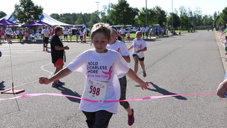 People take part in the Susan G. Komen Race for the Cure Saturday at Forestview Middle School in Baxter. (Kelly Humphrey, Brainerd Dispatch - Gallery and Video)